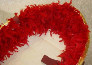 Gold Ecopod with red feathers